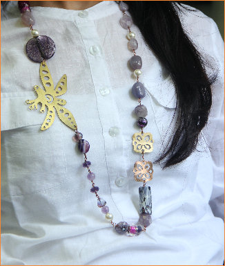 Shades of purple in semi-precious and glass beads with Copper and Brass motif